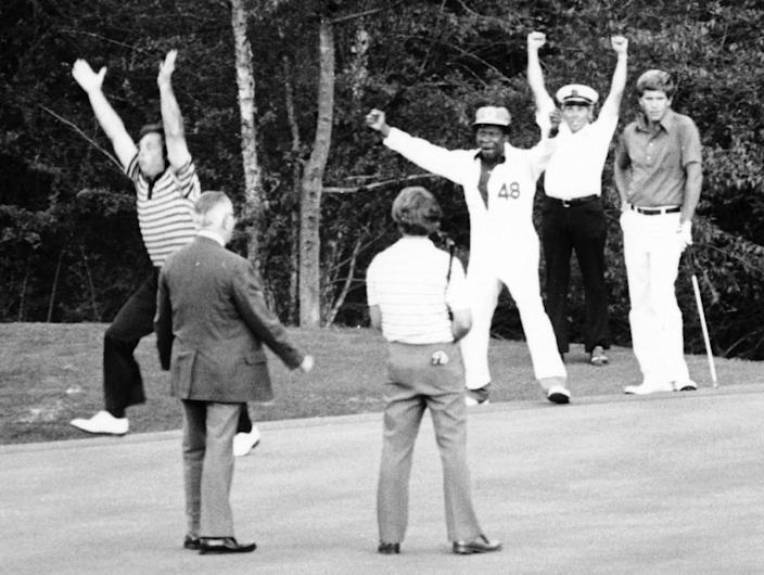 With caddie Jariah Beard cheering, Fuzzy Zoeller holes a putt to win the 1979 Masters.