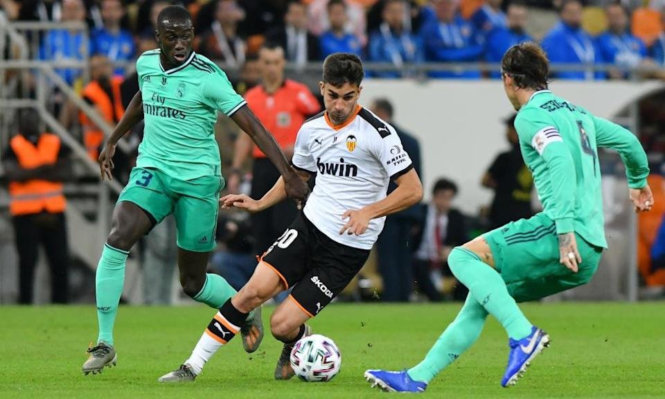 Ferran Torres attempts to get the better of Real Madrid's Sergio Ramos (right) and Ferland Mendy during Valencia's Spanish Super Cup semi-final in January 2020.