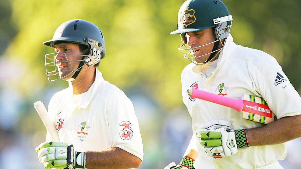 Matthew Hayden (pictured right) jogging off with Ricky Ponting (pictured left).