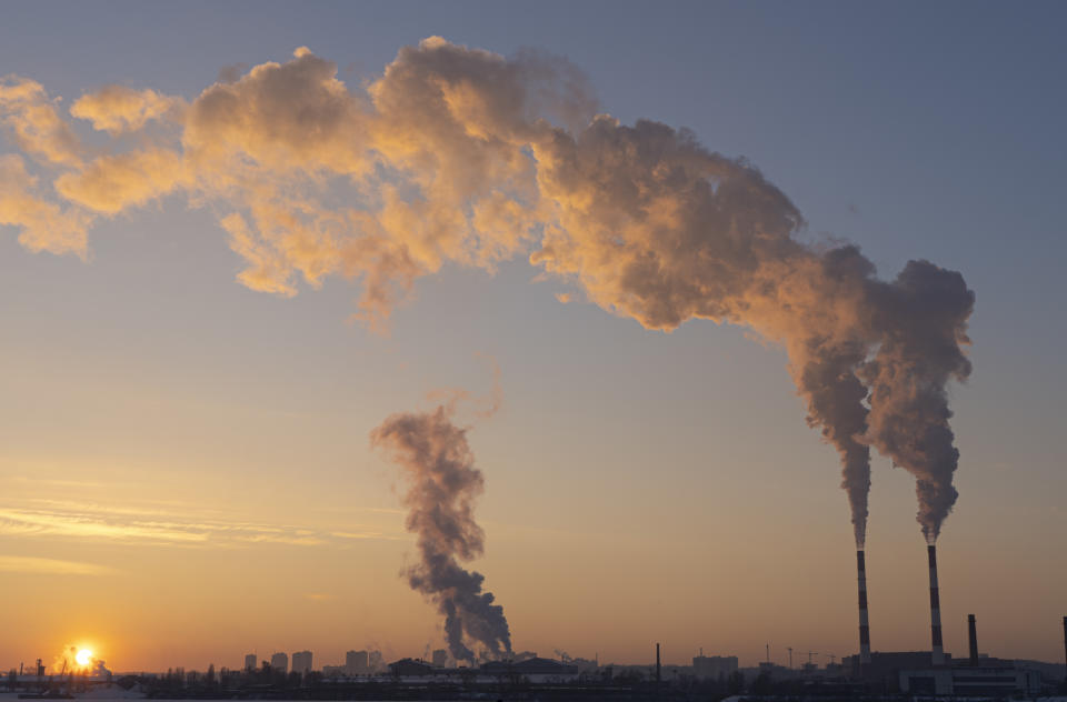 Environmental pollution. Global warming. Climate change. Dirty energy. Factory chimneys emit harmful substances into air