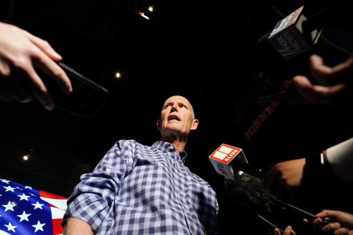 Sen. Rick Scott, R-Fla., speaks to the media after a campaign rally for Republican candidates for U.S. Senate Sen. Kelly Loeffler and Sen. David Perdue on Friday, Nov. 13, 2020, in Cumming, Ga. (AP Photo/Brynn Anderson)