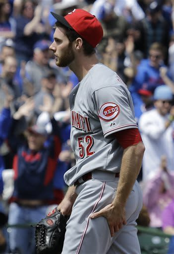Cincinnati Reds starter Tony Cingrani reacts after Chicago Cubs' Alfonso Soriano hit a two-run home run during the third inning of a baseball game against the Cincinnati Reds in Chicago, Saturday, May 4, 2013. (AP Photo/Nam Y. Huh)