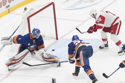 Detroit Red Wings left wing Thomas Vanek (26) scores a goal past New York Islanders goaltender Thomas Greiss (1) to tie during the third period of an NHL hockey game, Saturday, Dec. 15, 2018, in Uniondale, N.Y. (AP Photo/Mary Altaffer)