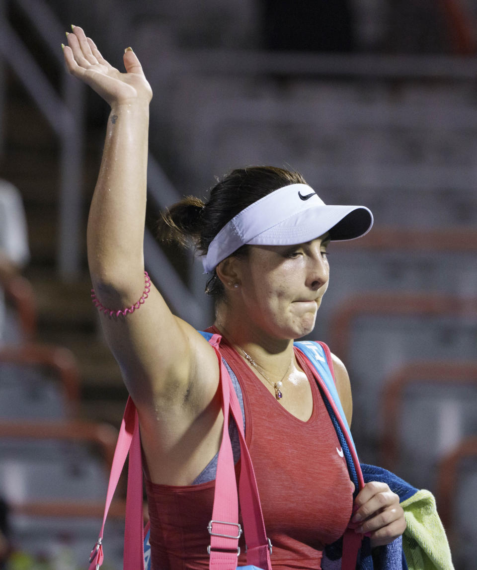 Canada's Bianca Andreescu waves while walking off the court after losing to Ons Jabeur, of Tunisia, during the National Bank Open women's tennis tournament Thursday, Aug. 12, 2021, in Montreal. (Paul Chiasson/The Canadian Press via AP)