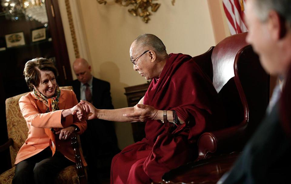 <p>Meeting with the Dalai Lama in 2014.</p>