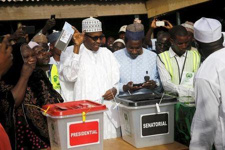 All Progressives Congresses presidential candidate and Nigeria's former military ruler Muhammodu Buhari casts his vote in Daura