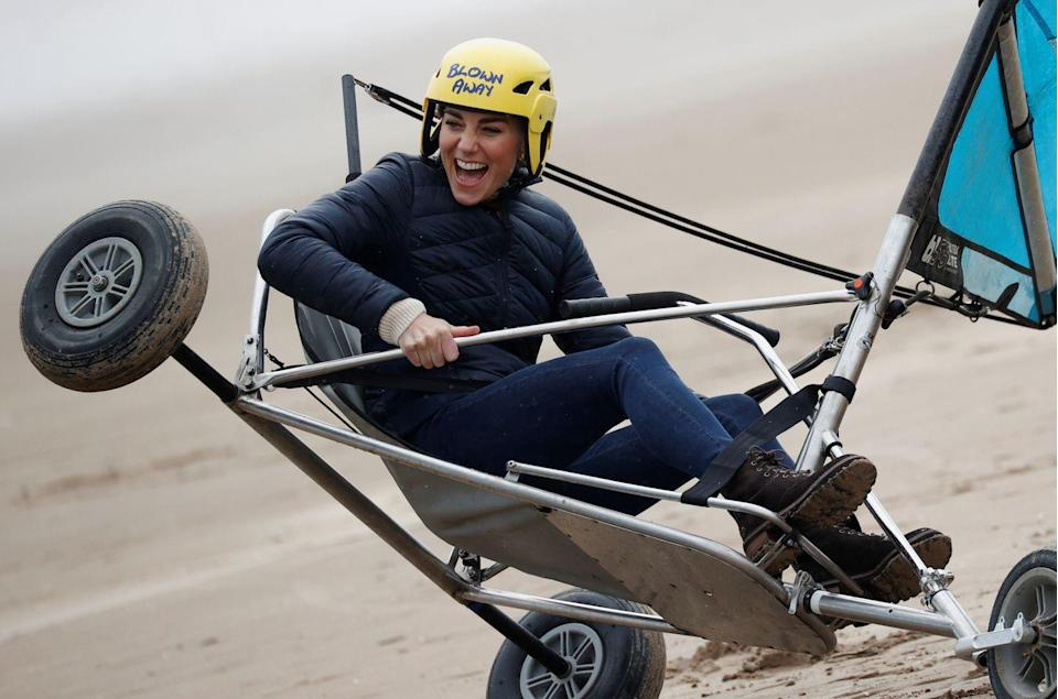 """<p>The Duke and Duchess of Cambridge went """"land yachting"""" on the beaches of St Andrews, Scotland. The pair got a bit competitive, racing each other on the sand. Kate even appeared to get a bit stuck (as seen here) and required some assistance—she seemed unfazed, however, laughing and smiling the whole time. </p>"""