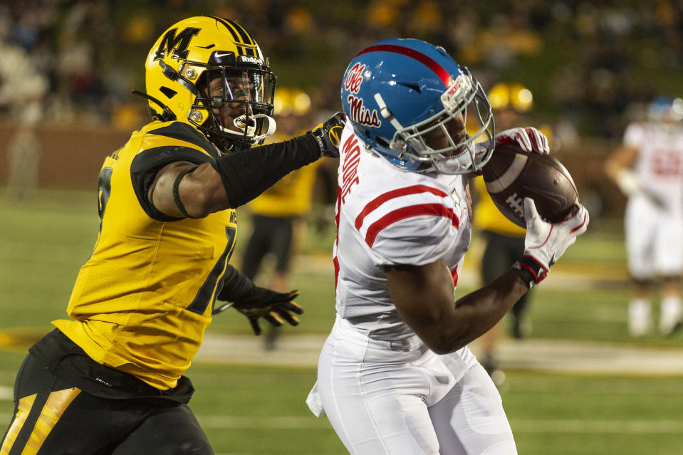 Mississippi wide receiver Elijah Moore, right, pulls in a touchdown pass in front of Missouri safety Joshuah Bledsoe during the third quarter of an NCAA college football game Saturday, Oct. 12, 2019, in Columbia, Mo. (AP Photo/L.G. Patterson)
