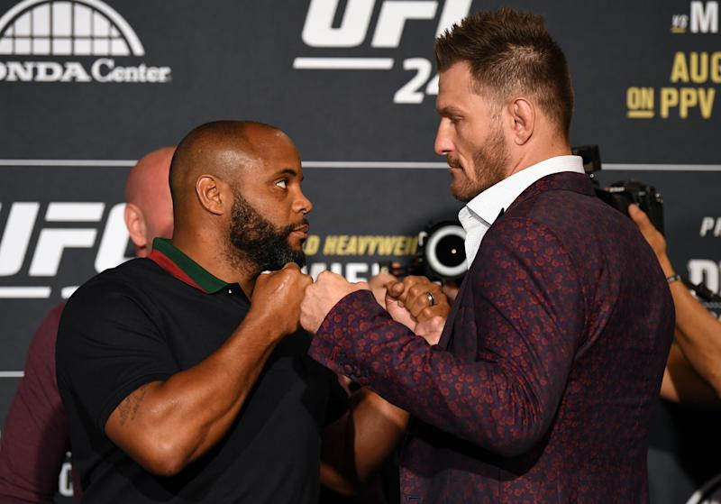 ANAHEIM, CALIFORNIA - AUGUST 15: (L-R) Daniel Cormier and Stipe Miocic face off during the UFC 241 Ultimate Media Day at the Hilton Anaheim hotel on August 15, 2019 in Anaheim, California. (Photo by Josh Hedges/Zuffa LLC/Zuffa LLC)