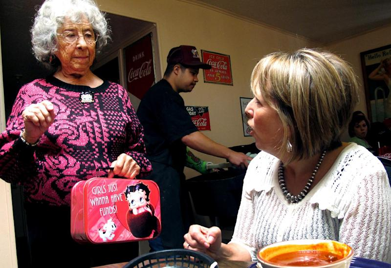 This photo taken Oct. 19, 2012 shows New Mexico Democratic Congressional candidate Michelle Lujan Grisham, right, talks with Betty Minero, 88, at Barelas Coffee House in Albuquerque, N.M. A total of 49 Latino candidates _ 32 Democrats, 16 Republicans and one without a declared party _ are seeking House seats this year, according to the bipartisan National Association of Latino Elected and Appointed Officials. Depending on how many of them win, their numbers in the House could make history. (AP Photo/Russell Contreras)