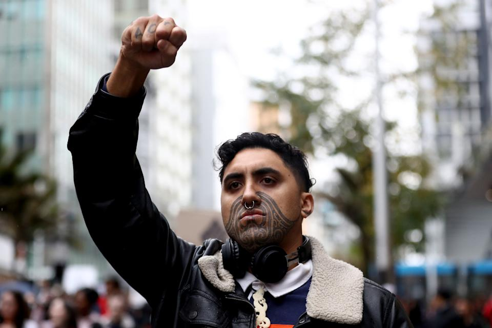 AUCKLAND, NEW ZEALAND - JUNE 01: A protestor marches down Queen Street on June 01, 2020 in Auckland, New Zealand. The rally was organised in solidarity with protests across the United States following the killing of an unarmed black man George Floyd at the hands of a police officer in Minneapolis, Minnesota.  (Photo by Hannah Peters/Getty Images) (Photo: Hannah Peters via Getty Images)