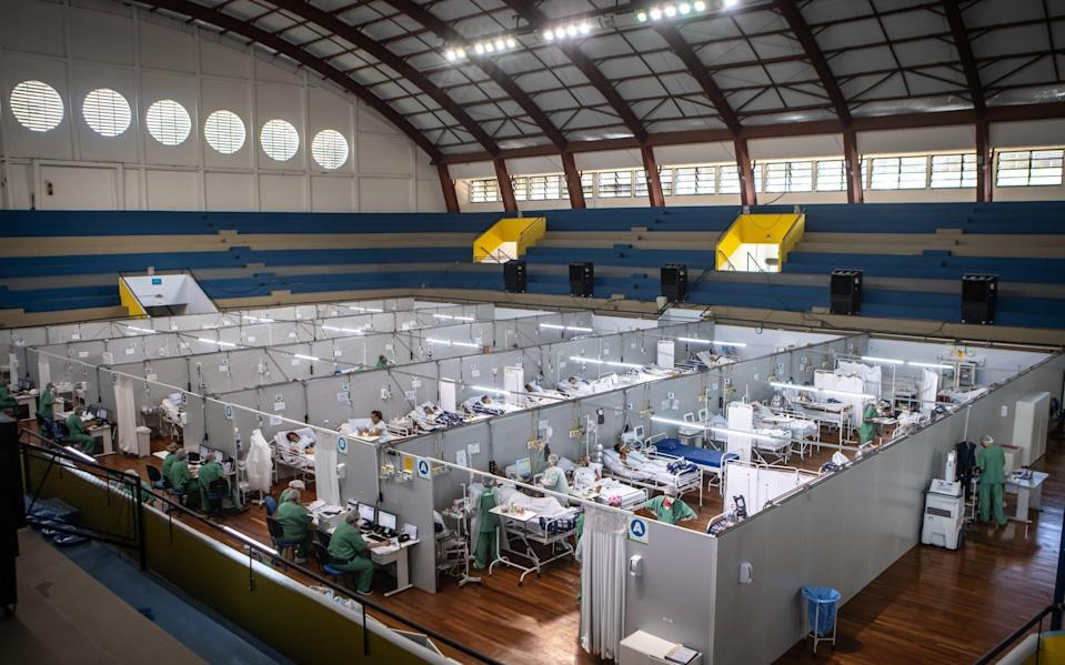 Healthcare workers treat Covid patients in a field hospital at the Pedro Dell'Antonia sports complex in Santo Andre, Brazil - Jonne Roriz/Bloomberg