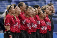 Members of team Canada stand during the playing of their national anthem ahead of a softball game against Mexico at the 2020 Summer Olympics, Tuesday, July 27, 2021, in Yokohama, Japan (AP Photo/Sue Ogrocki)