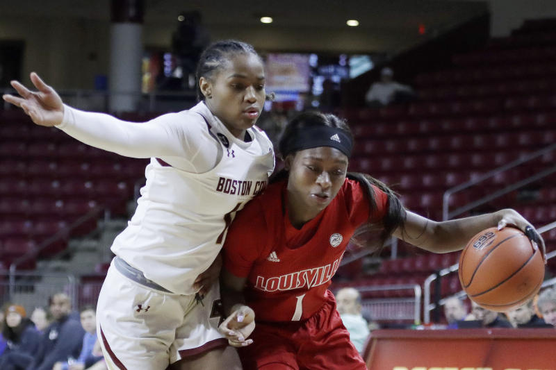 Louisville guard Dana Evans (1) drives against Boston College guard Marnelle Garraud during the second half of an NCAA college basketball game Thursday, Jan. 16, 2020, in Boston. Louisville won 81-70. (AP Photo/Elise Amendola)