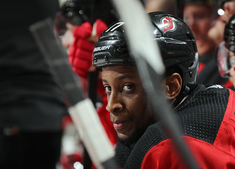 Wayne Simmonds #17 of the New Jersey Devils watches the action from the bench during the game against the Minnesota Wild