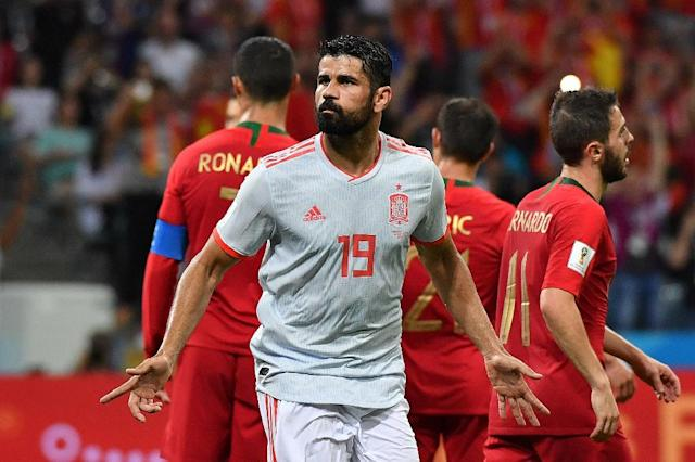 Diego Costa celebrates after scoring for Spain in Friday's thrilling 3-3 draw with Portugal in Sochi (AFP Photo/Nelson Almeida)