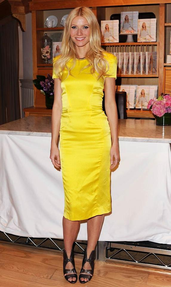 "Gwyneth Paltrow looked yummy in a figure-hugging yellow Rachel Roy dress and fierce, gladiator-inspired Camilla Skovgaard sandals while signing copies of her new cookbook, <i>My Father's Daughter</i>, at a Williams-Sonoma in Beverly Hills. Jon Kopaloff/<a href=""http://www.filmmagic.com/"" target=""new"">FilmMagic.com</a> - April 21, 2011"