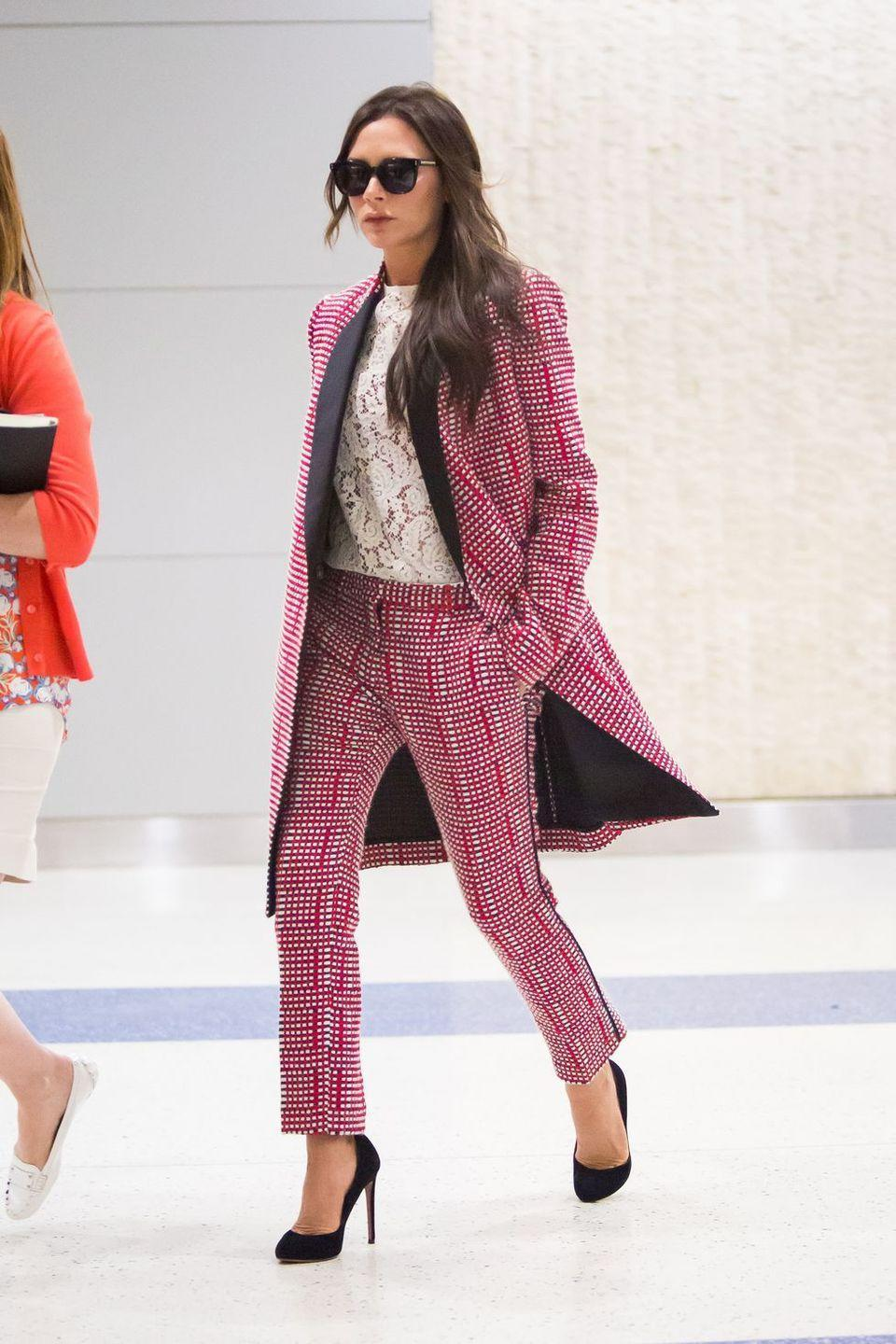 <p><strong>Victoria Beckham, 2015: </strong>Don't get me wrong, Victoria looks <em>great </em>here. But a matching two piece suit and heels to the airport feels like she's doing ~the most~.</p>