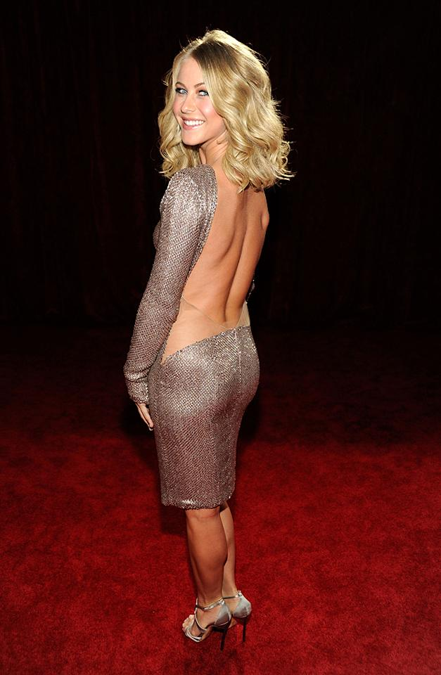 Pro dancer/singer/actress Julianne Hough showed off some serious skin in a backless frock. (01/11/2012)