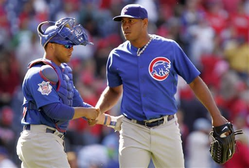 Chicago Cubs catcher Wellington Castillo, left, and pitcher Carlos Marmol shake hands on the mound after the Cubs the Philadelphia Phillies 5-1 in a baseball game, Sunday, April 29, 2012, in Philadelphia. (AP Photo/Tom Mihalek)