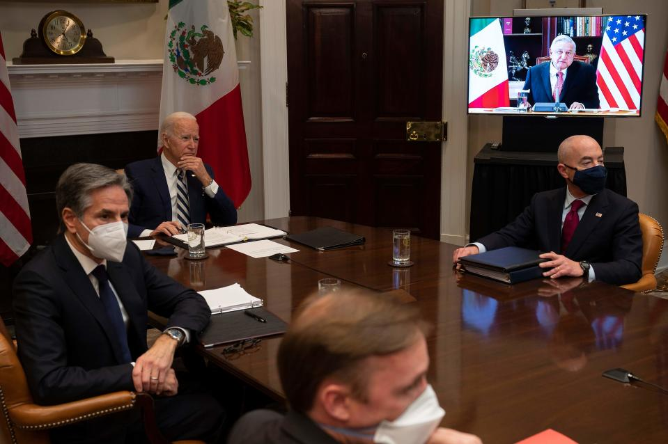 US President Joe Biden (C), flanked by US Secretary of State Antony Blinken (L) and US Secretary of Homeland Security Alejandro Mayorkas (R), meets virtually with Mexican  President Andres Manuel Lopez Obrador at the White House in Washington, DC, on March 1, 2021. (Photo by JIM WATSON / AFP) (Photo by JIM WATSON/AFP via Getty Images)