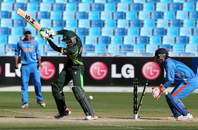 DUBAI, UNITED ARAB EMIRATES - FEBRUARY 15: Hassan Razza of Pakistan is bowled by Sarfaraz Khan of India during the ICC U19 Cricket World Cup 2014 match between India and Pakistan at the Dubai Sports City Cricket Stadium on February 15, 2014 in Dubai, United Arab Emirates. (Photo by Francois Nel - IDI/IDI via Getty Images)