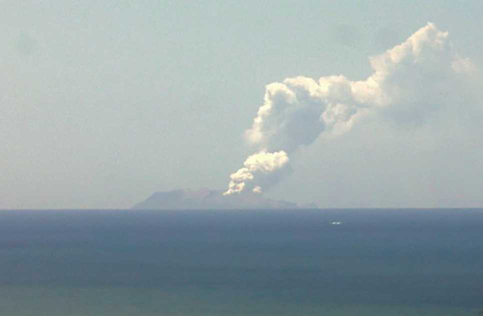 A plume of smoke rises from the volcano on White Island (Picture: AP)