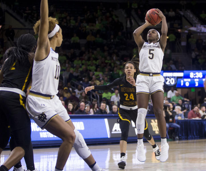 Notre Dame's Jackie Young (5) goes up for a shot in front of Bethune-Cookman's Angel Golden (24) during a first-round game in the NCAA women's college basketball tournament in South Bend, Ind., Saturday, March 23, 2019. (AP Photo/Robert Franklin)