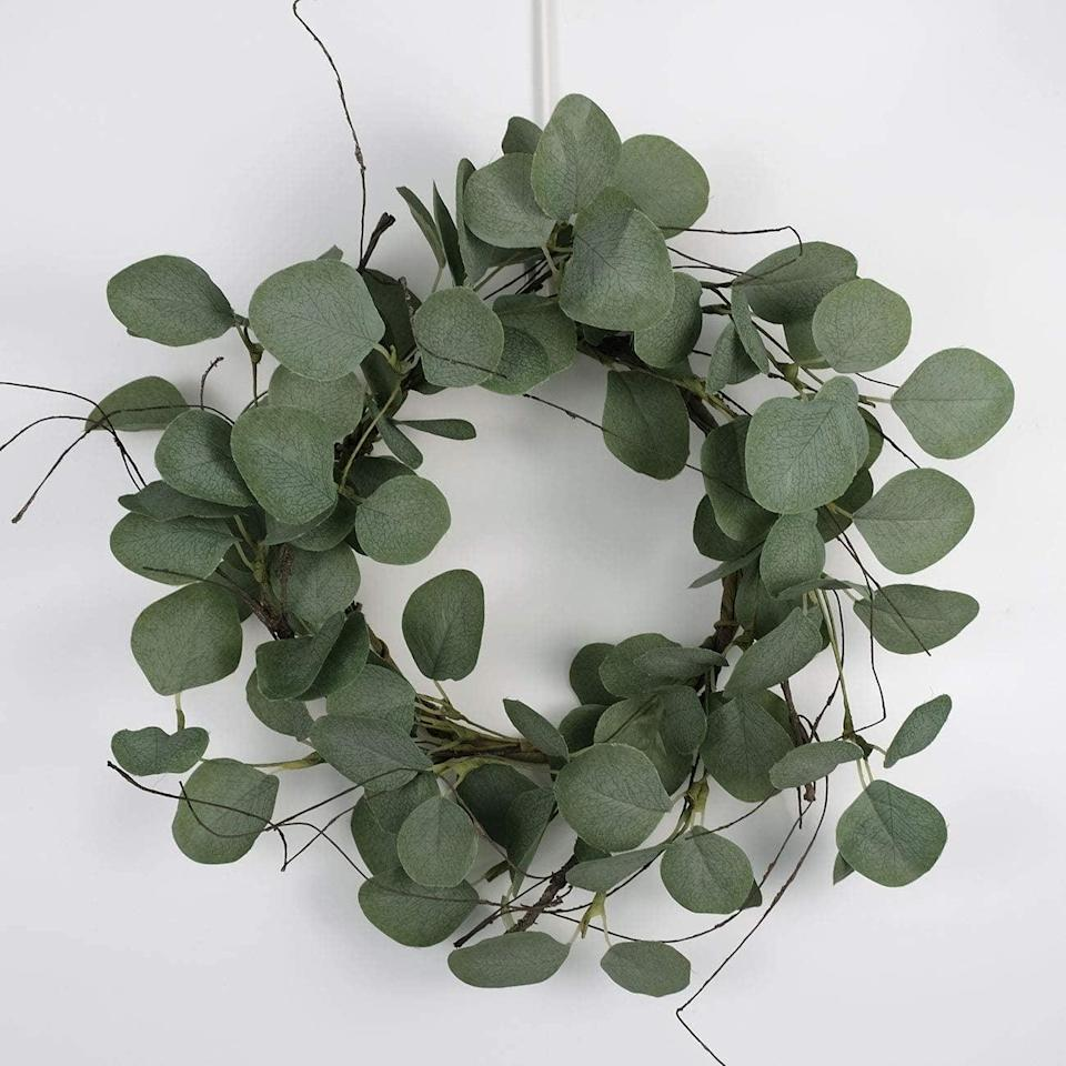 <p>If you want to add a natural element to your decor but don't have a green thumb, the <span>Idyllic Eucalyptus Leaves Wreath Metal Polyester Fabric Paper Round Green Wreath 2 Packs</span> ($24) are perfect.</p>