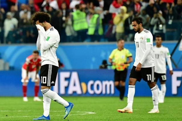 Mohamed Salah (L) and Egypt endured a difficult night against Russia and are already staring at the World Cup exit door