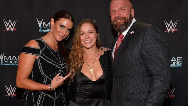 Stephanie McMahon, Rousey and Triple H. Image: Getty