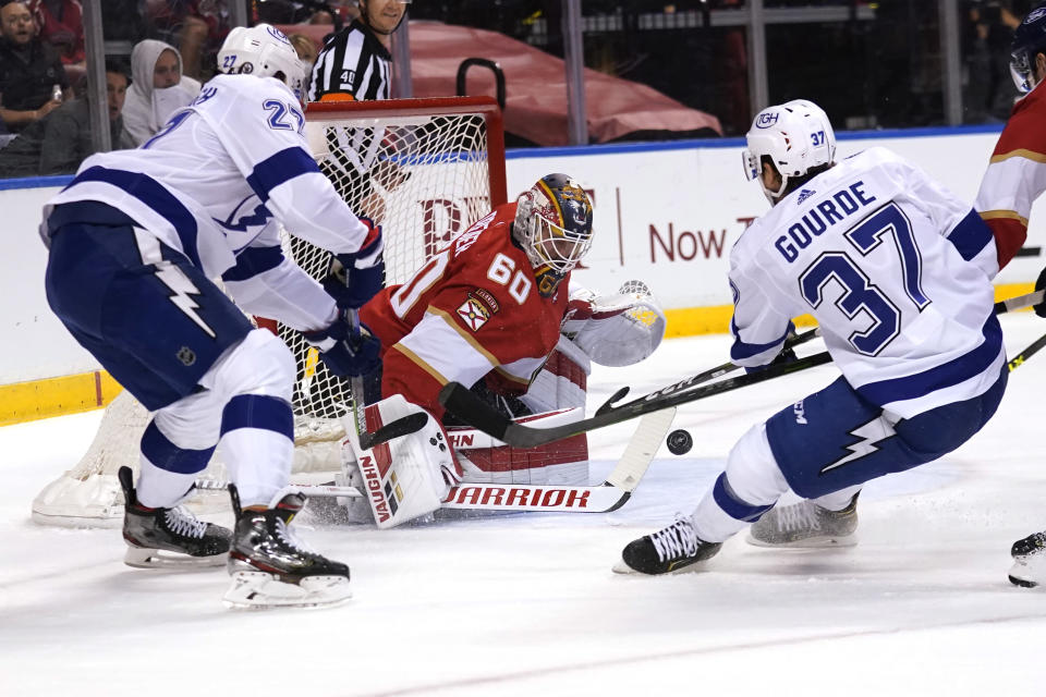 Florida Panthers goaltender Chris Driedger (60) defends against Tampa Bay Lightning defenseman Ryan McDonagh (27) and center Yanni Gourde (37) during the first period in Game 2 of an NHL hockey Stanley Cup first-round playoff series Tuesday, May 18, 2021, in Sunrise, Fla. (AP Photo/Lynne Sladky)