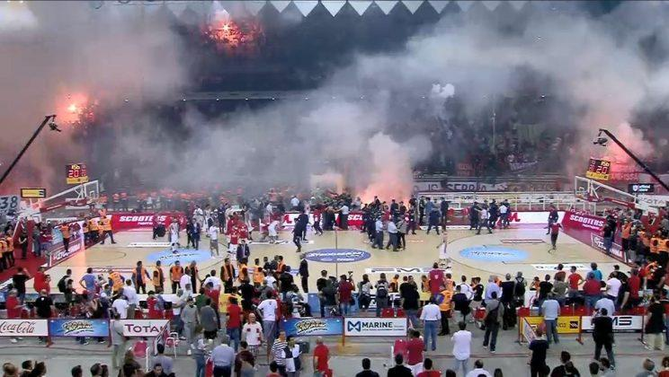 Olympiakos fans set Peace and Friendship Stadium ablaze at the end of a loss to Panathinaikos. (@EneaTrapani on Twitter)