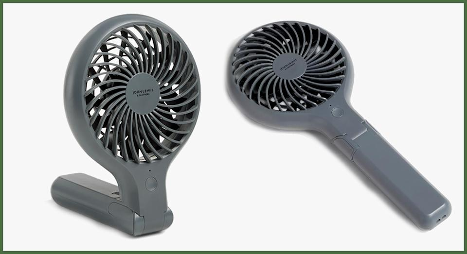 The versatile fan can be handheld or propped up to sit on a desk or surface. (John Lewis & Partners)