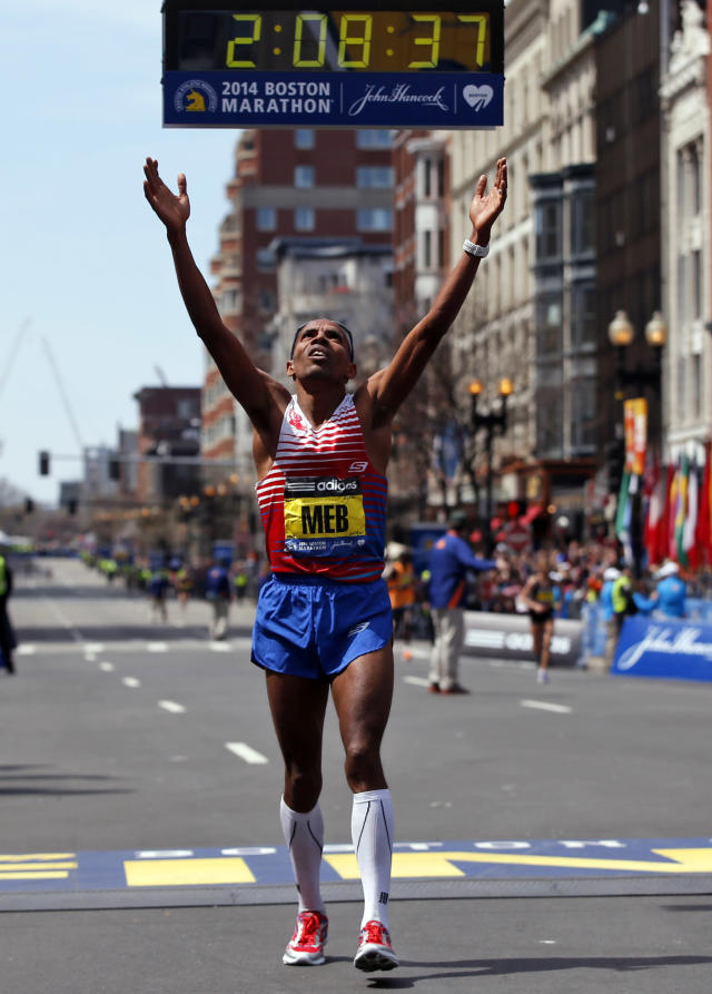 Meb Keflezighi, of San Diego, Calif., celebrates his win in the 118th Boston Marathon Monday, April 21, 2014 in Boston. (AP Photo/Elise Amendola)
