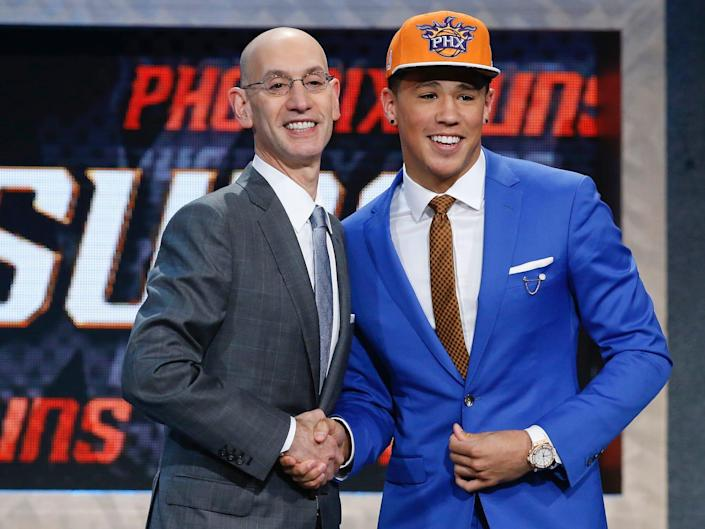 Devin Booker poses with Adam Silver at the 2015 draft.