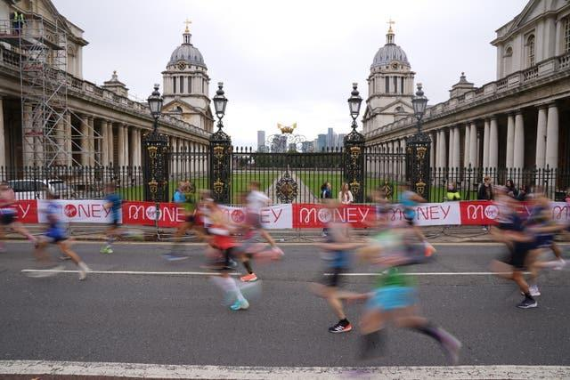 Runners pass the Old Naval College