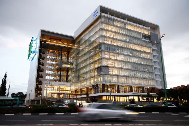 "Cars drive past U.S. chipmaker Intel Corp's ""smart building"" in Petah Tikva, near Tel Aviv"