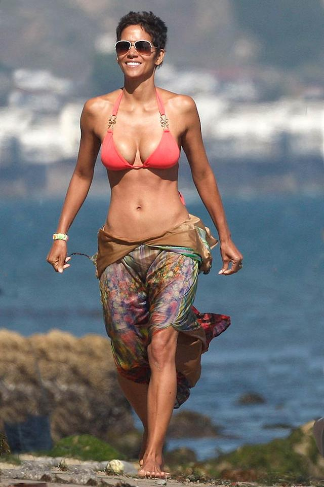 """Halle Berry was all smiles as she frolicked with friends and family at her Malibu beach birthday bash last weekend. The hot mama -- who turned 45 on Sunday -- showed off her fit physique in a pink bikini and watercolor sarong. As the saying goes, if you've got it, flaunt it! MAP/<a href=""""http://www.splashnewsonline.com"""" target=""""new"""">Splash News</a> - August 14, 2011"""