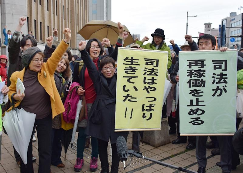 Japanese anti-nuclear activists celebrate after the Fukui District Court issued an injuction in April 2015, blocking the restart of two atomic reactors at the Takahama nuclear power plant (AFP Photo/)