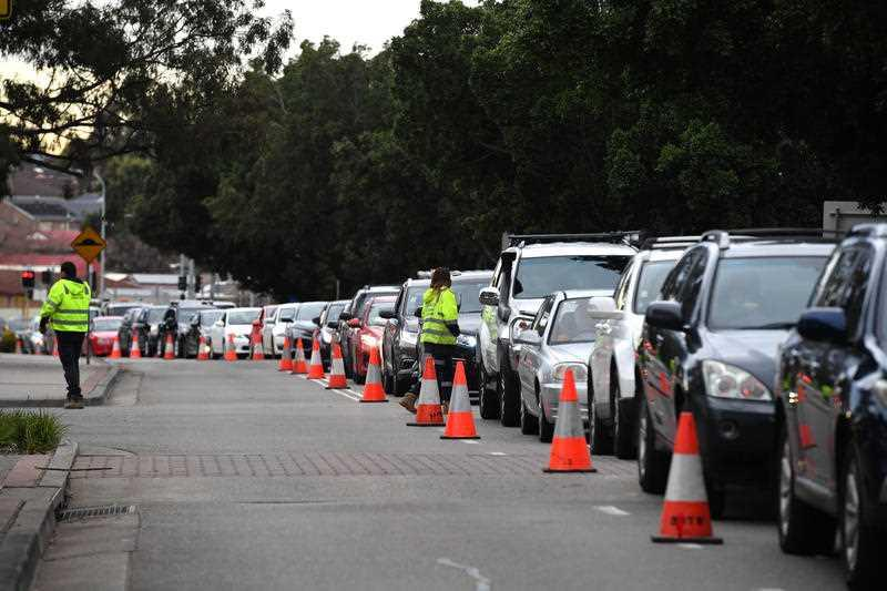 Long queues of cars are seen at a pop up Covid testing clinic at the Fairfield Showgrounds in Sydney.