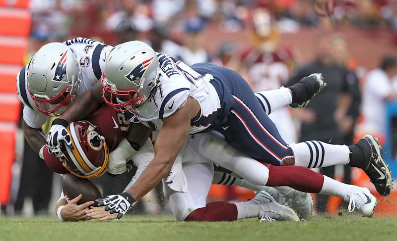 New England Patriots outside linebacker Dont'a Hightower (54) and New England Patriots defensive end Michael Bennett (77) sack Washington Redskins quarterback Colt McCoy (Getty Images)