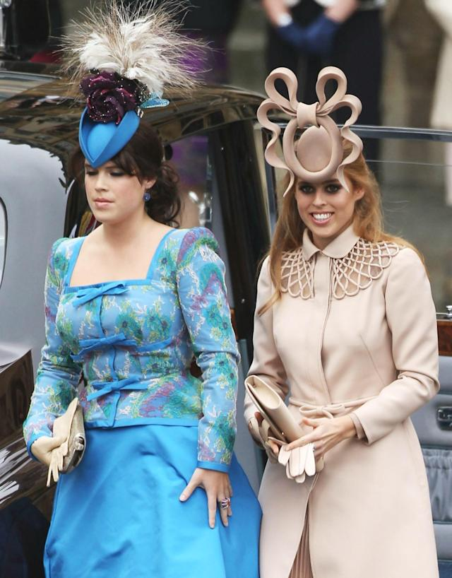 Princesses Eugenie and Beatrice's headpieces definitely gave royal watchers something to talk about at Prince William and Kate Middleton's wedding. (Photo: Getty Images)