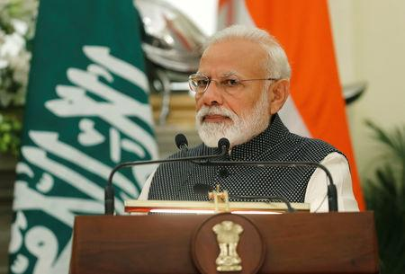 FILE PHOTO - Indian Prime Minister Narendra Modi listens to Saudi Arabia's Crown Prince Mohammed bin Salman as he speaks during their meeting at Hyderabad House in New Delhi