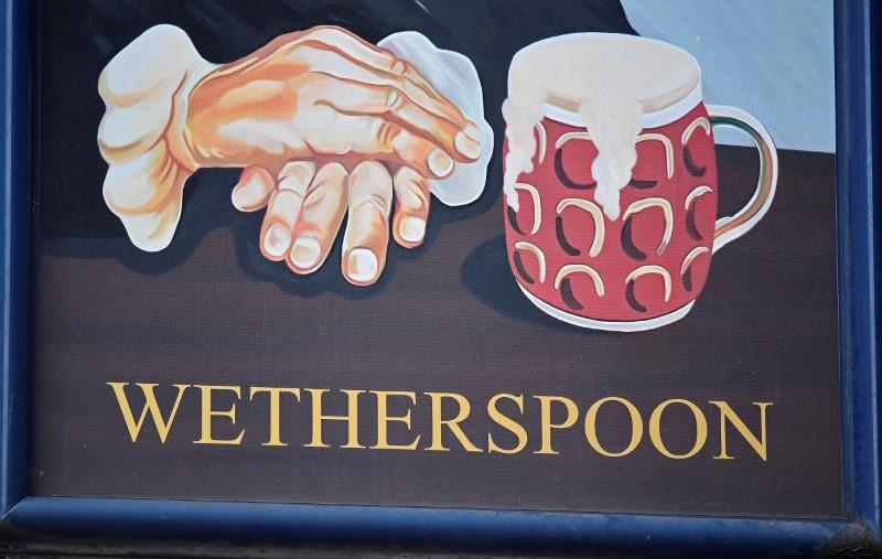 FILE PHOTO: A Wetherspoon's logo is seen at a pub in central London, Britain