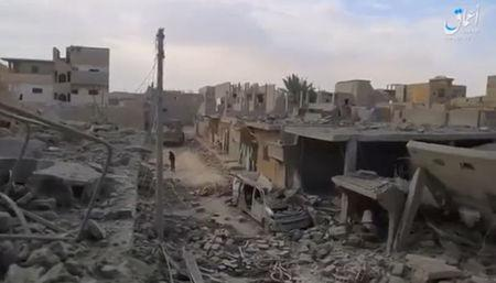 A still image taken from a video released on the internet by Islamic State-affiliated Amaq News Agency, on April 18, 2017, purports to show the aftermath, said to be in al-Bukamal town, in Deir al-Zor province, after air strikes thought to have been directed by planes from a U.S.-led military coalition, Syria. Social Media Website via Reuters TV