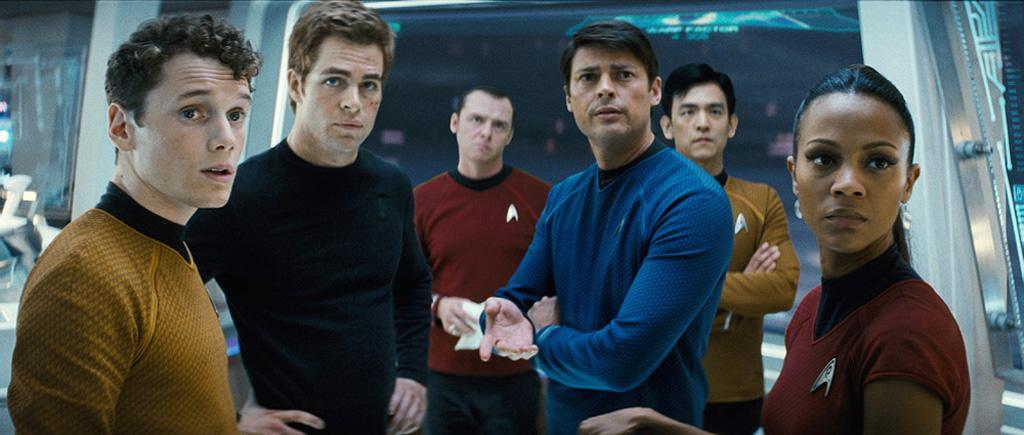 "In this photo we see the bulk of the Enterprise crew in their uniforms for the first time. The colors and designs are taken straight out of the original series, but the fabrics look more modern. The writers said the show's costumes captured the feel of the ""Beatles/Kennedy '60s"" and wanted the movie to retain that ""rebellious spirit."" They also noted that Kirk (<a href=""http://movies.yahoo.com/movie/contributor/1808520306"">Chris Pine</a>) is not wearing a uniform in this shot, and that there's a definite reason for that in the plot."