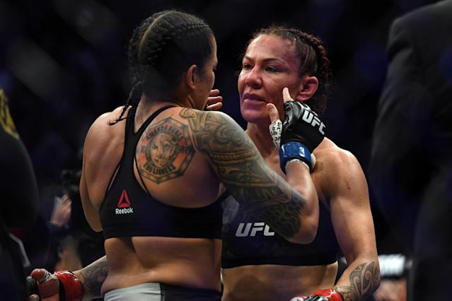 Amanda Nunes hugs Cris Cyborg after Nunes defeated her by first-round KO to become the new UFC featherweight champion during UFC 232 on Dec 29, 2018. in Inglewood, California. (Getty Images)