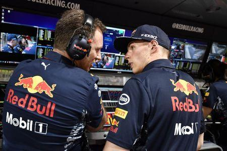 Formula One - F1 - Bahrain Grand Prix - Sakhir, Bahrain - 16/04/17 - Red Bull's Dutch driver Max Verstappen talks to team Chief Christian Horner ahead of the race. REUTERS/Andrej Isakovic/Pool