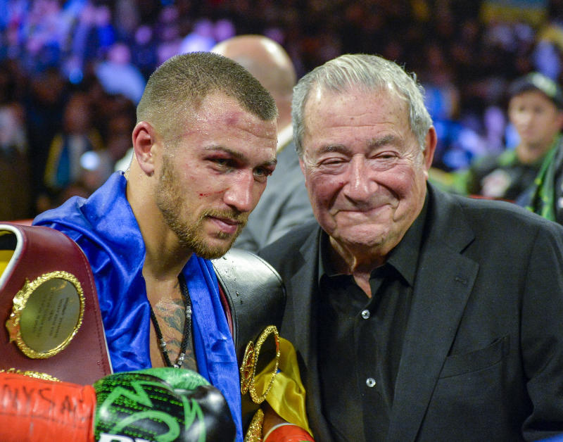 Vasiliy Lomachenko poses with promoter Bob Arum after defeating Jose Pedraza in the WBO title lightweight boxing match at Madison Square Garden, Saturday, Dec. 8, 2018, in New York. (AP Photo/Howard Simmons)